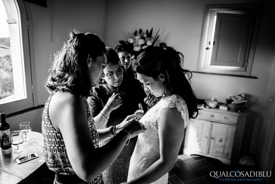 bride getting the wedding dress