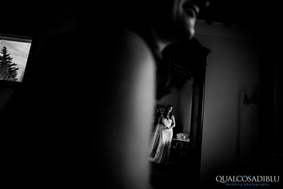bride in the mirror smiling black and white