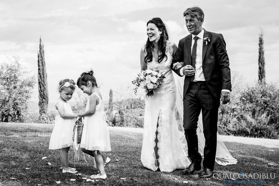 bride with father and ladies with flowers