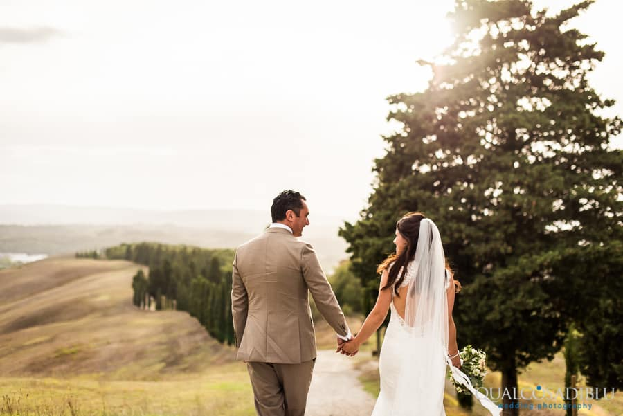 bride and groom in the tuscany hills