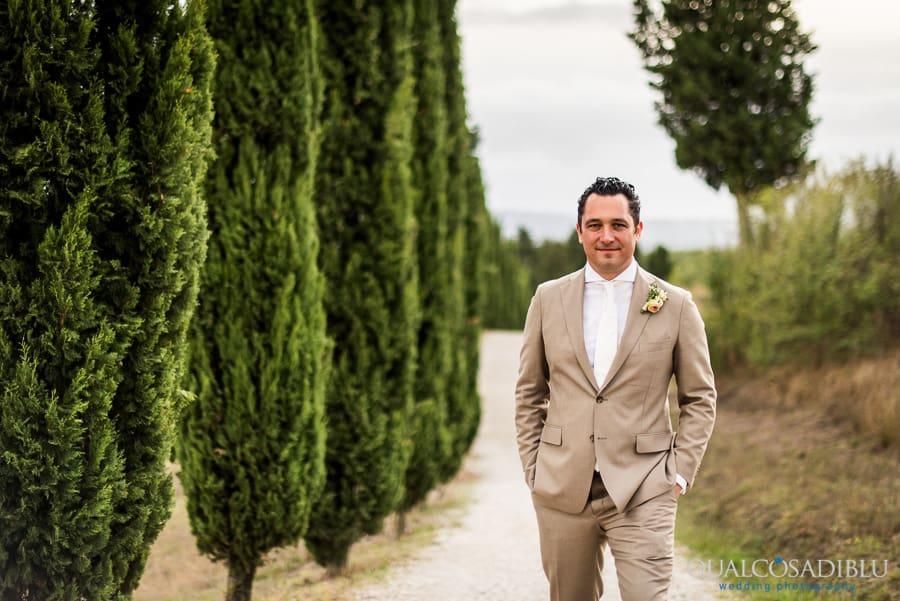 groom portrait tuscany cypresses