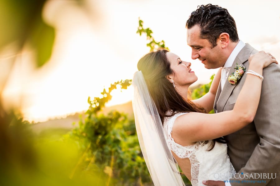 newlywed kissing in the vineyard