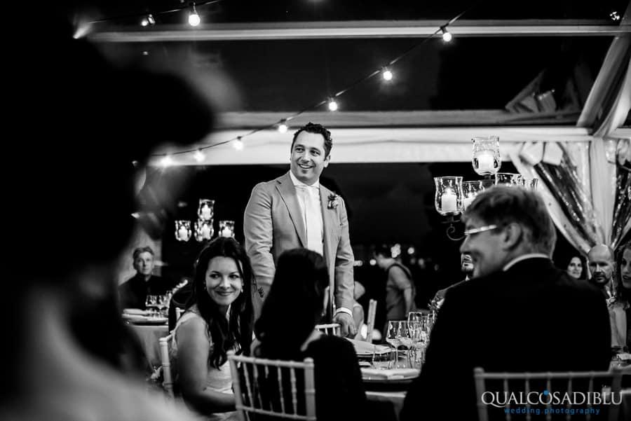 groom smiling wedding dinner