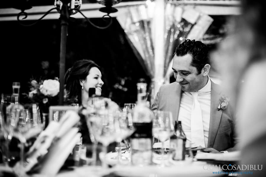 groom smiling candid moment dinner black and white