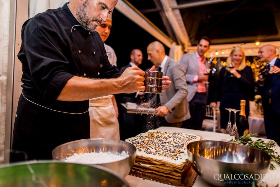 baker making the wedding cake