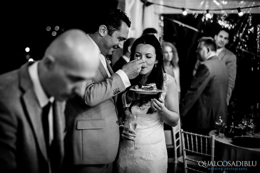 bride and groom eating the wedding cake