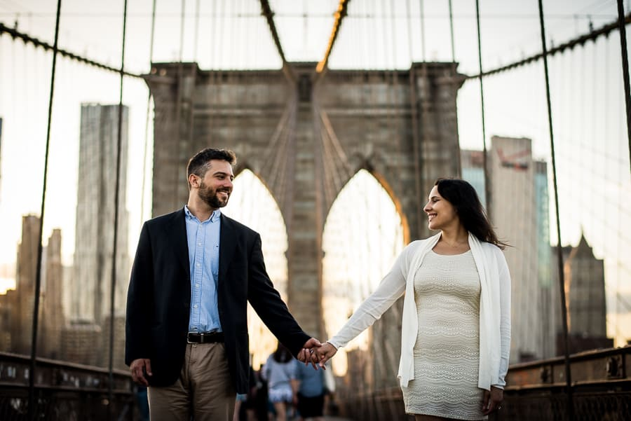 Lovely couple holdings their hands brooklyn bridge