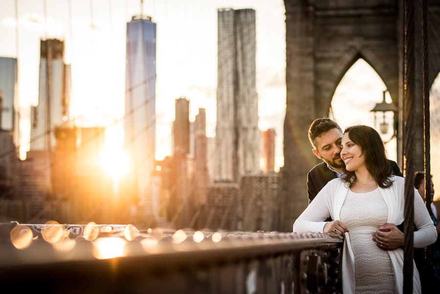 Embraced lovely couple at sunset on the brooklyn bridge