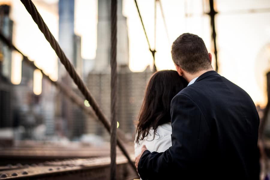 embraced couple together new york background