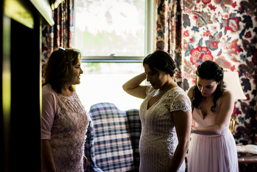 wedding getting ready bride white pink dress mother