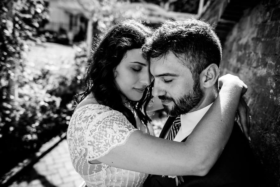 wedding bride groom hug black and white