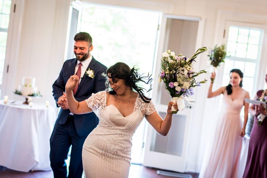 bridge and groom dancing and having fun