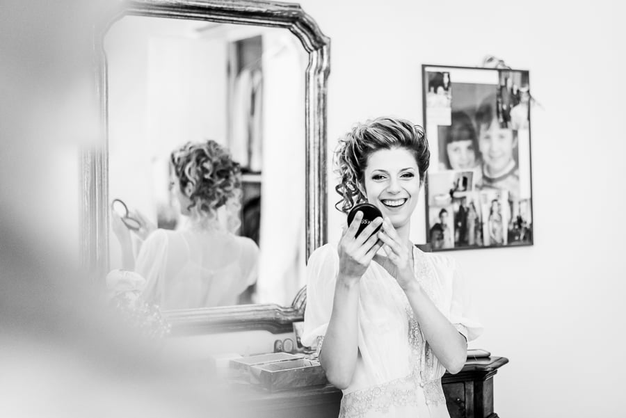 bride smiling looking at mirror