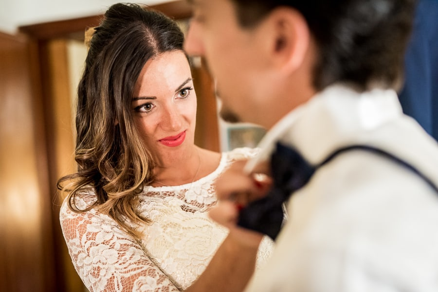 sister of groom adjusting bow tie