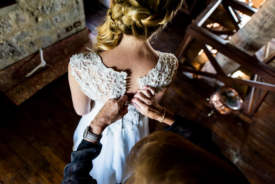 mother of the bride lacing the wedding dress