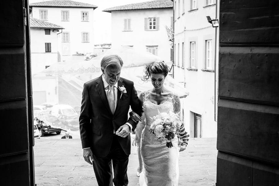 bride and father coming to the church