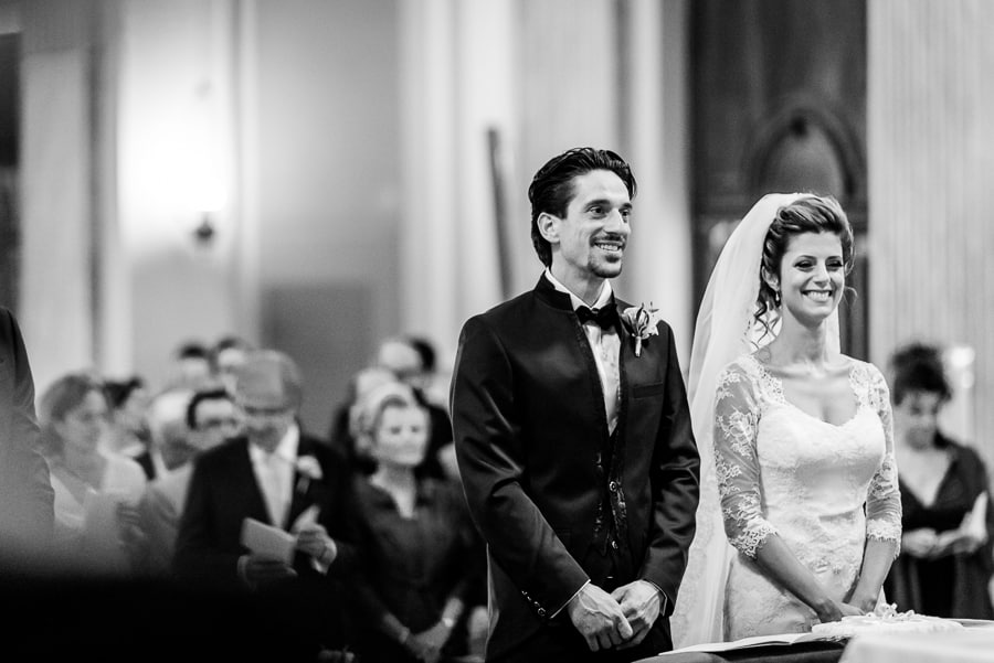 bride groom smiling church black and white