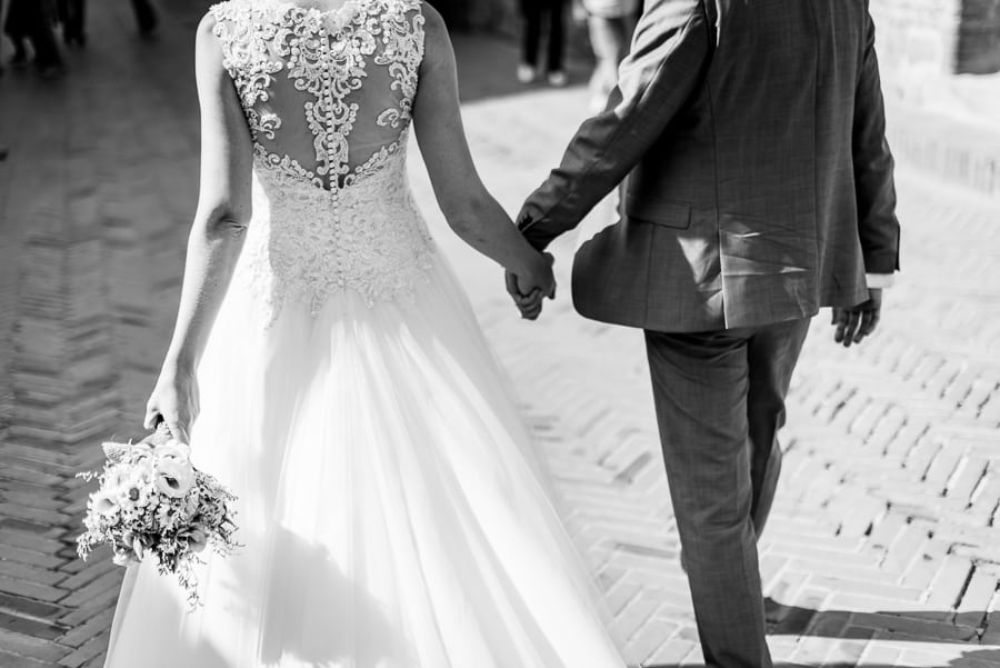 bride groom holding their hands certaldo black and white