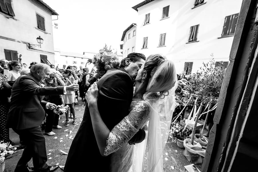 bride groom kissing black and white