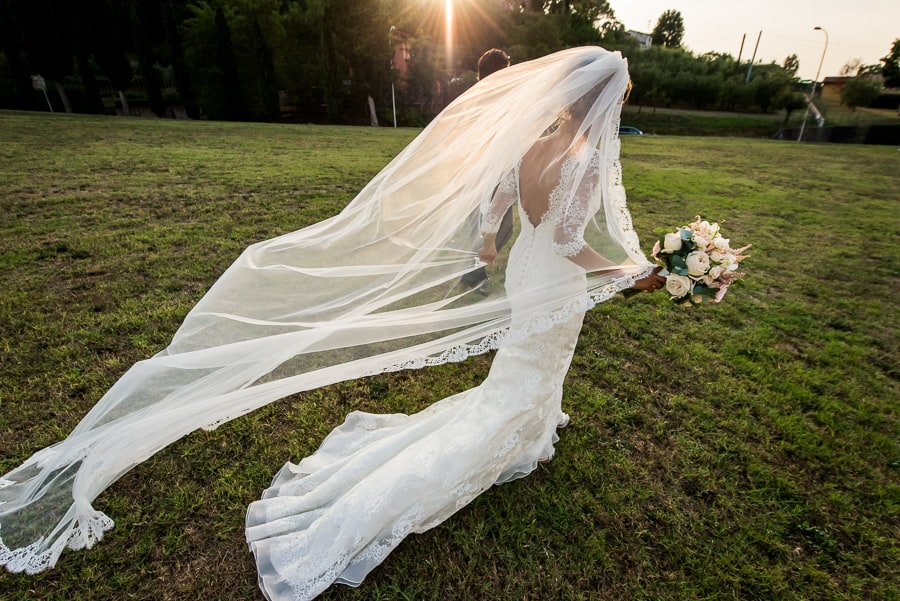 bride walking with long veil