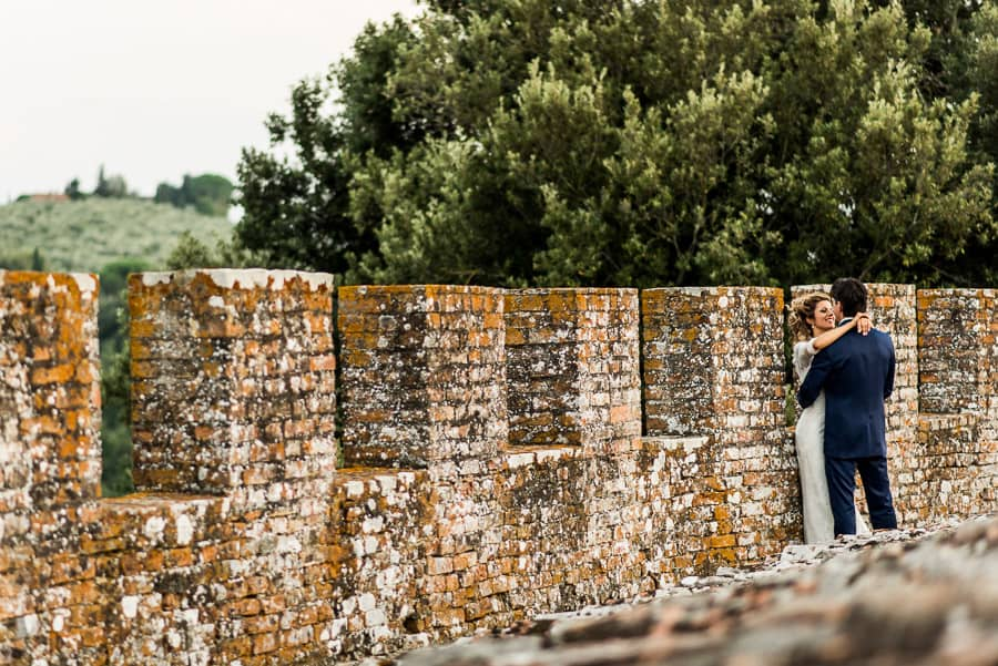 bride and groom embraced oliveto castle