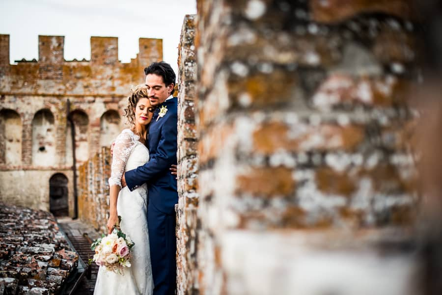 bride groom intimate embraced walls castle oliveto