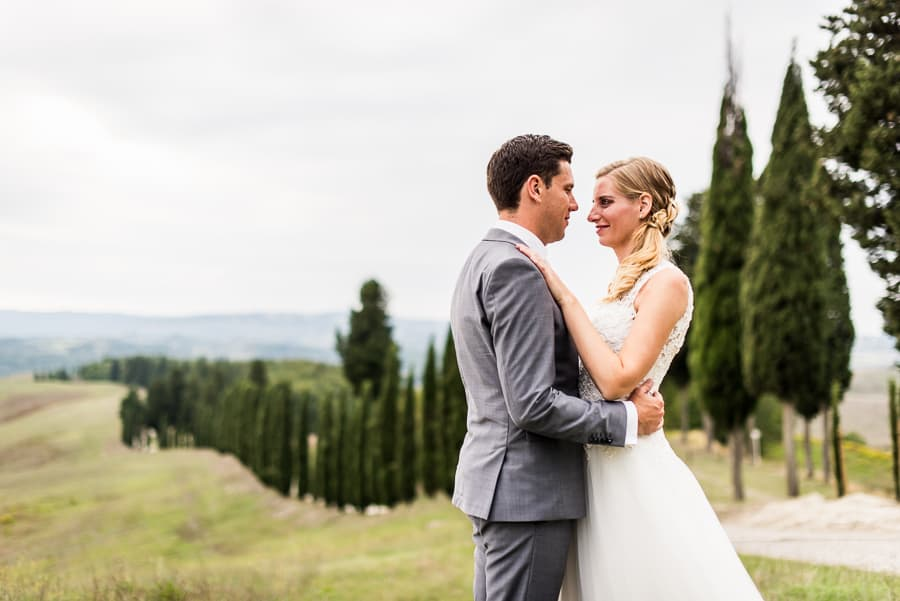 wedding couple tuscany cypresses backdrop