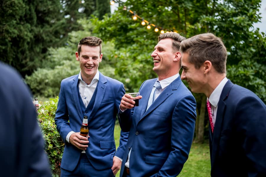 guests smiling drinking beer