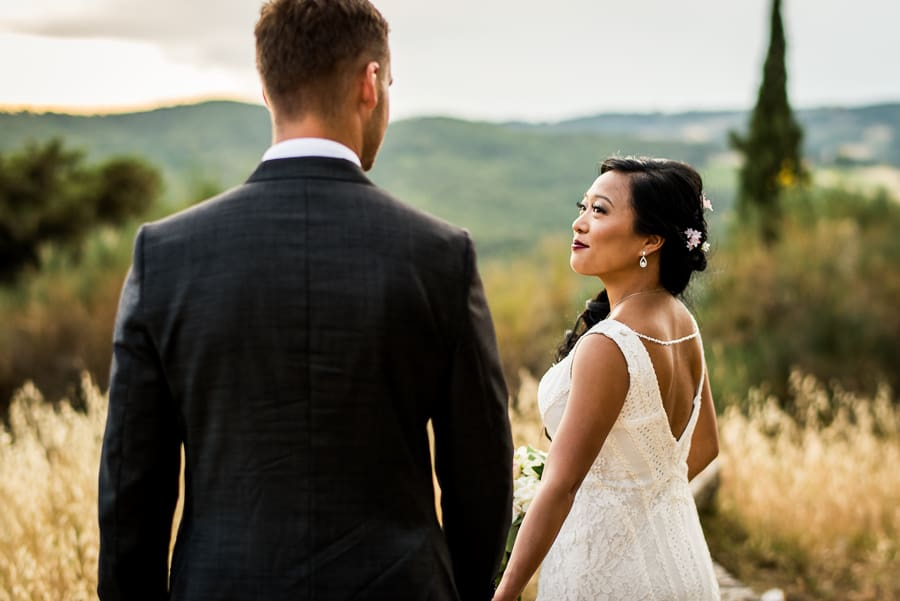 bride walking with groom shooting