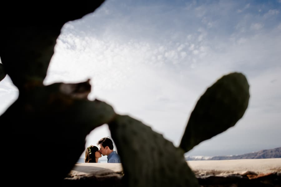 couple kissing at imerovigli santorini