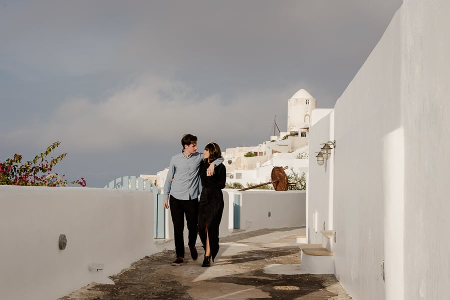 couple walking together santorini greece