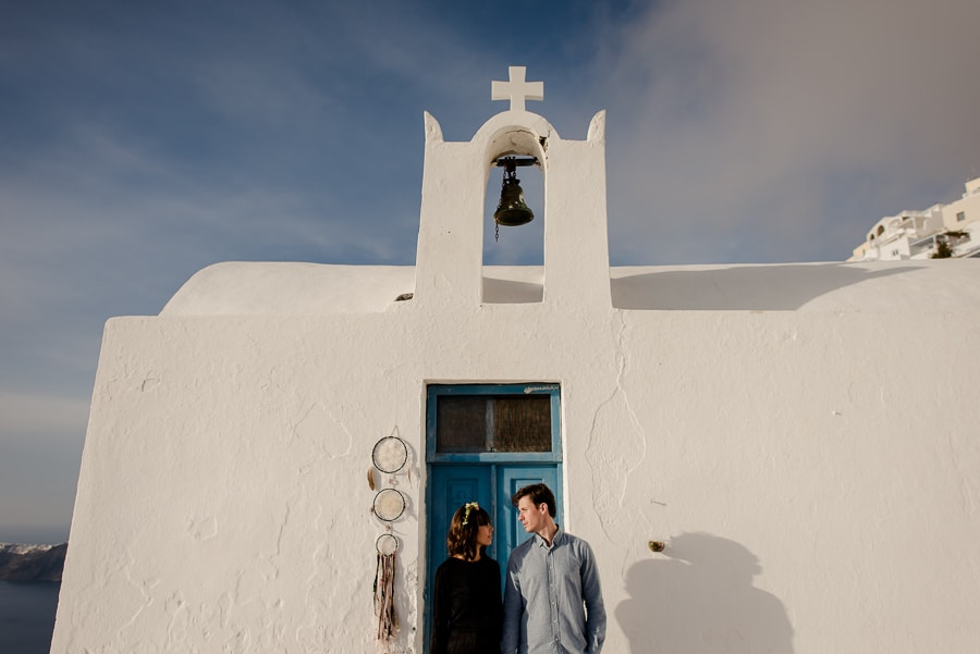 couple engaged in a church at imerovigli