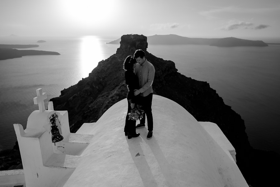 embraced couple skaros rock roof church