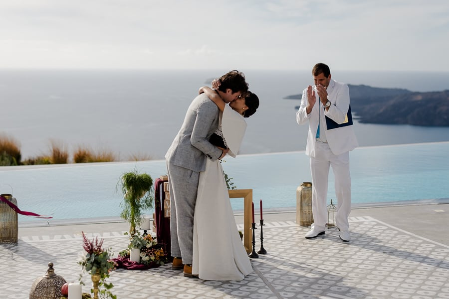 bride and groom embracing each other wedding ceremony santorini
