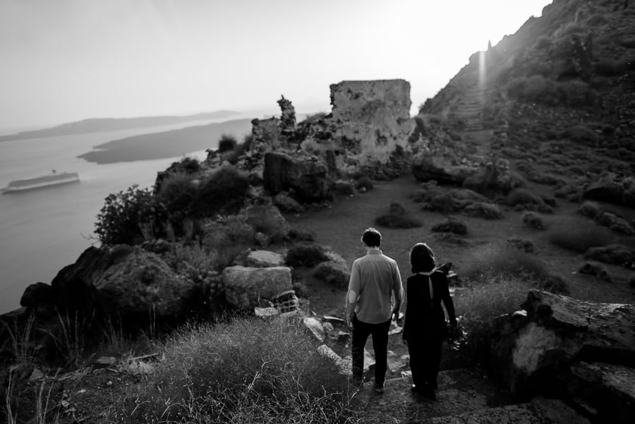 couple engaged walking to skaros rock santorini