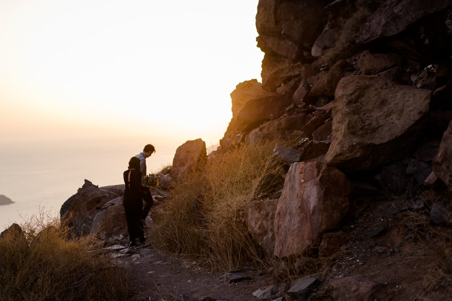 engaged couple walking in skaros rock sunset magic light