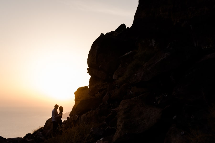 engagement sunset couple embraced skaros rock imerovigli santorini