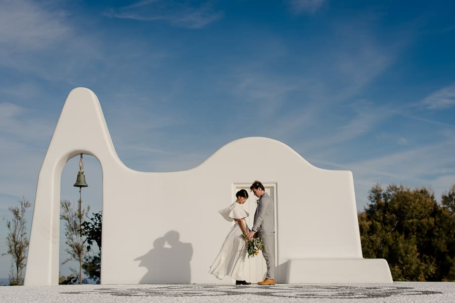 bride and groom intimate church santorini