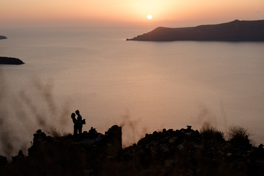 couple embraced sunset skaros rock imerovigli santorini