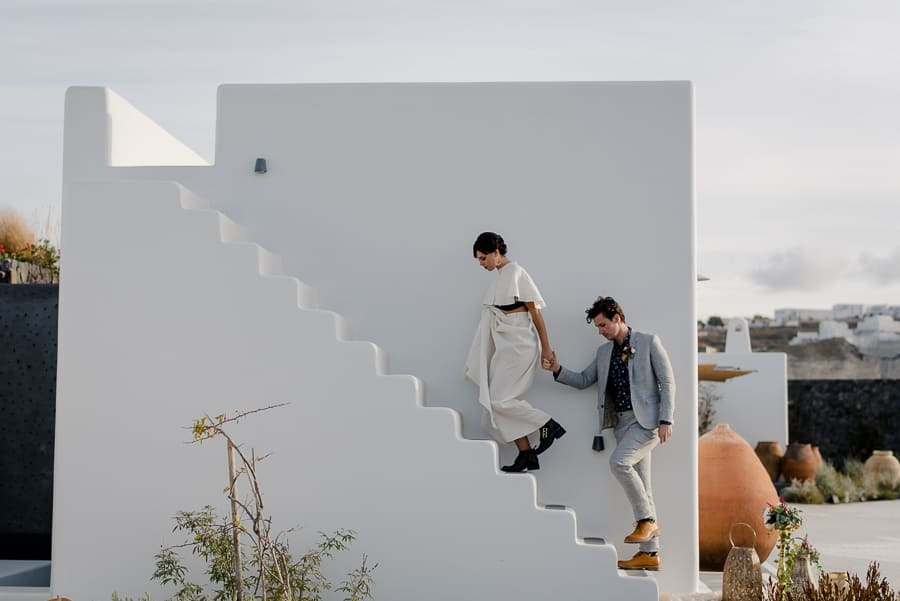 bride and groom going up to a typical building santorini wedding