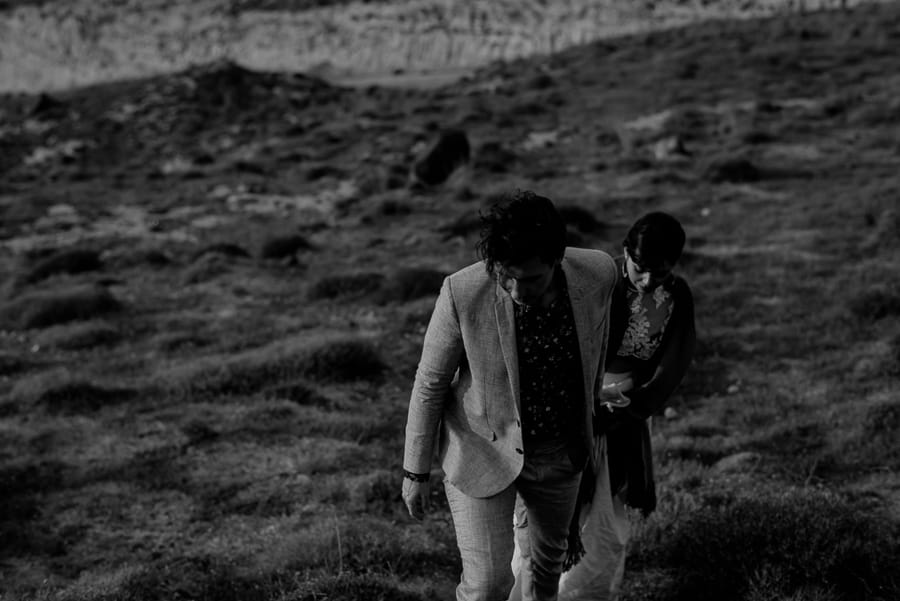 bride and groom walking together santorini