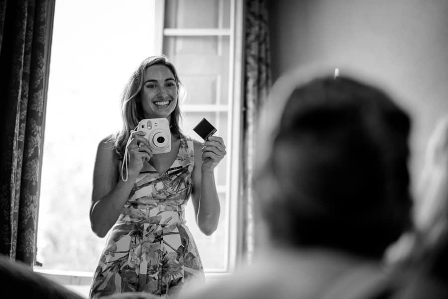 bride shooting with polaroid camera