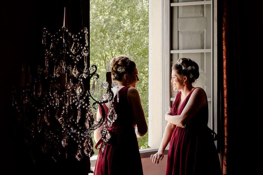 Bridesmaids at the window at Villa il Salicone Pistoia