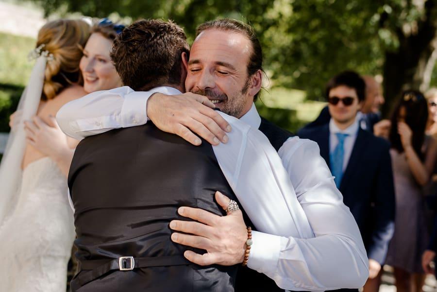 Best man hug the groom