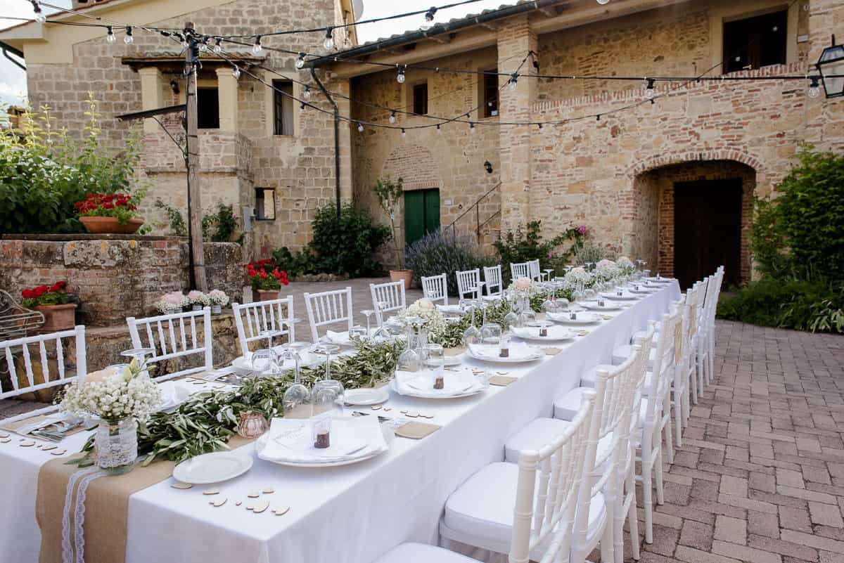 tenuta di papena courtyard with wedding tables