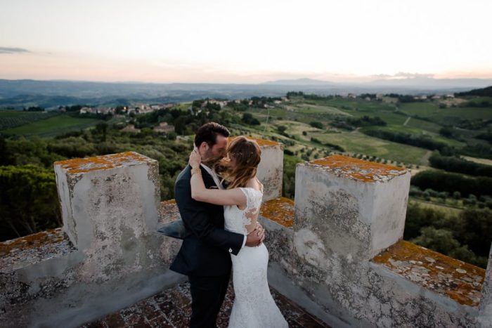 couple embracing at the top of a medieval tower
