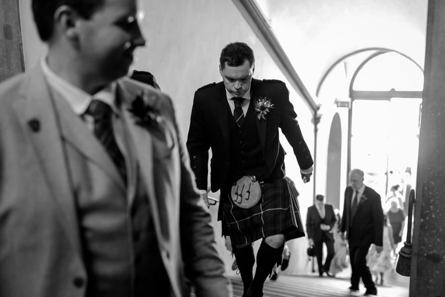 groom walking to the palazzo vecchio florence for wedding ceremony