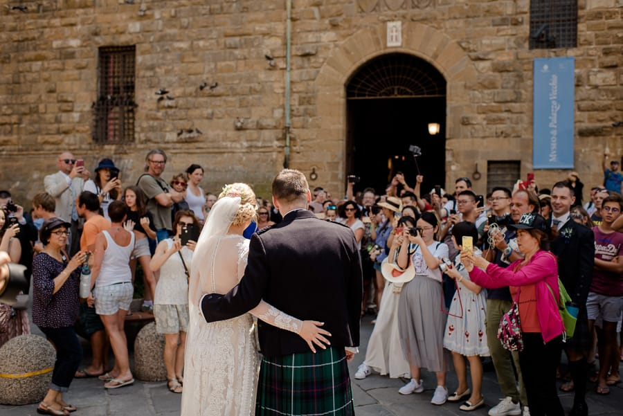 Bride and Groom announce theirselves in front to the people in florence