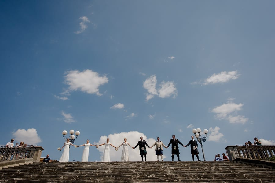 Group photo bridal party at piazzale michelangelo in Florence