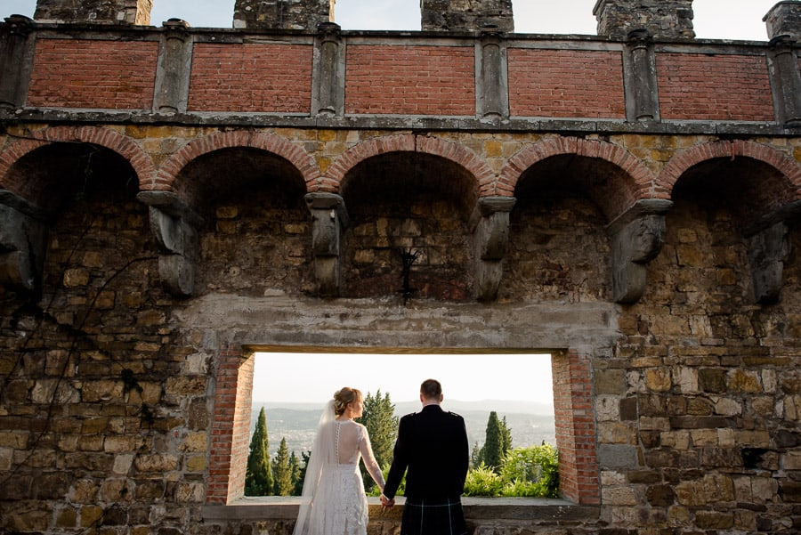 bride and groom window in the sky vincigliata castle florence